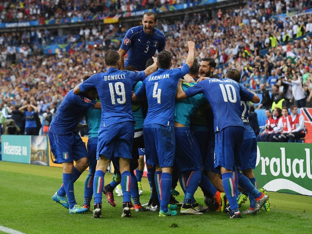 Italy players celebrate their team's second goal by Graziano Pelle (obscured) during the UEFA EURO 2016 round of 16 match between Italy and Spain at Stade de France on June 27, 2016 in Paris, France