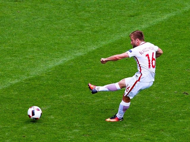 Jakub Blaszczykowski scores the opening goal during the Euro 2016 RO16 match between Switzerland and Poland on June 25, 2016