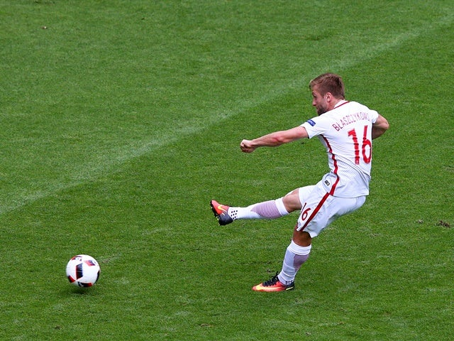 Jakub Blaszczykowski scores the opening goal during the Euro 2016 RO16 match between Switzerland and Poland on June 25, 2016