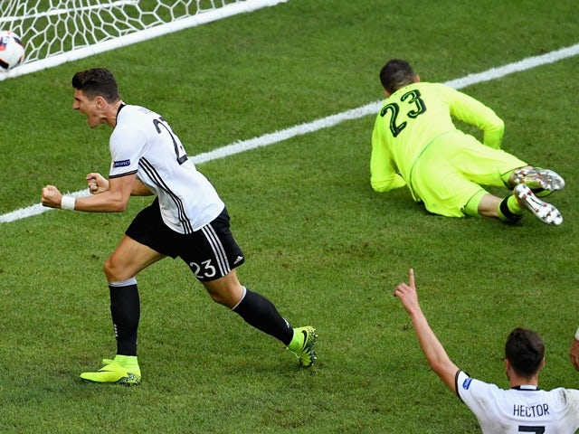 Mario Gomez celebrates scoring his side's second goal during the Euro 2016 RO16 match between Germany and Slovakia on June 26, 2016