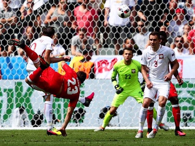 Xherdan Shaqiri scores during the Euro 2016 RO16 match between Switzerland and Poland on June 25, 2016