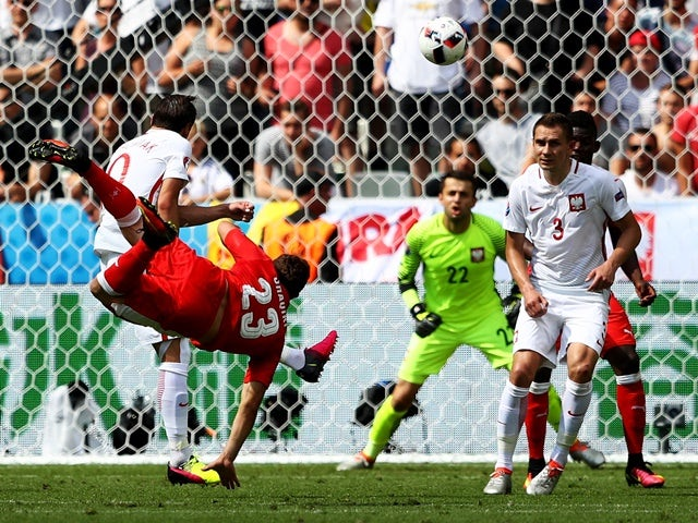 Xherdan Shaqiri scores during the Euro 2016 RO16 match between Switzerland and Poland on June 25, 2016