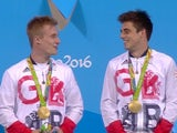 Chris Mears and Jack Laugher pose with their gold medals after winning the men's 3m synchro at the Rio Olympics on August 10, 2016