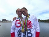 Team GB's Helen Glover and Heather Stanning pose with their gold medals at the Rio Olympics on August 12, 2016