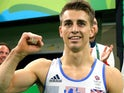 Max Whitlock celebrates winning floor gold at the Rio Olympics on August 14, 2016