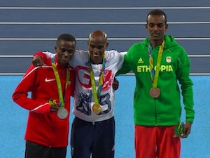 Mo Farah poses with his gold medal after the men's 10,000m at the Rio Olympics on August 13, 2016