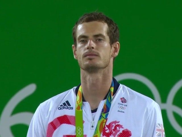 A jubilant Andy Murray collects his gold medal on August 14, 2016