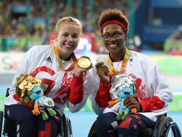 Hannah Cockroft and Kare Adenegan pose with their medals after the women's 100m T34 final at the Paralympic Games in Rio de Janeiro on September 10, 2016