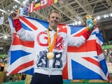 Jody Cundy poses with his gold medal and the GB flag after winning gold in the men's C4-5 1000m time trial event at the Paralympic Games in Rio de Janeiro on September 9, 2016