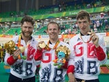 Jon-Allan Butterworth, Jody Cundy and Louis Rolfe pose with their gold medals after winning the mixed C1-5 750m team sprint at the Paralympic Games in Rio de Janeiro on September 11, 2016