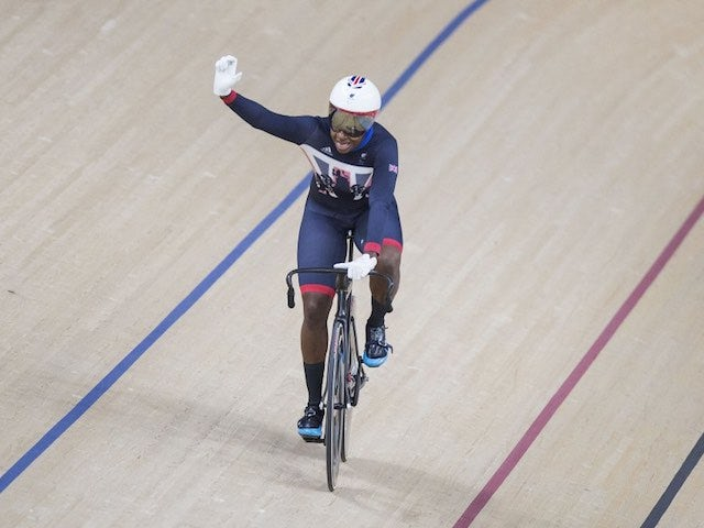 Kadeena Cox celebrates winning gold in the women's C4-5 500m time trial at the Paralympic Games in Rio de Janeiro on September 10, 2016