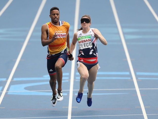 Libby Clegg and guide Chris Clarke in action for Paralympics GB during the women's T11 100m event at the Rio Games on September 9, 2016