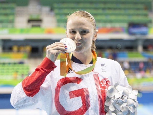 Stephanie Slater poses with her silver medal after the women's 100m butterfly S8 final at the Paralympic Games in Rio de Janeiro on September 9, 2016