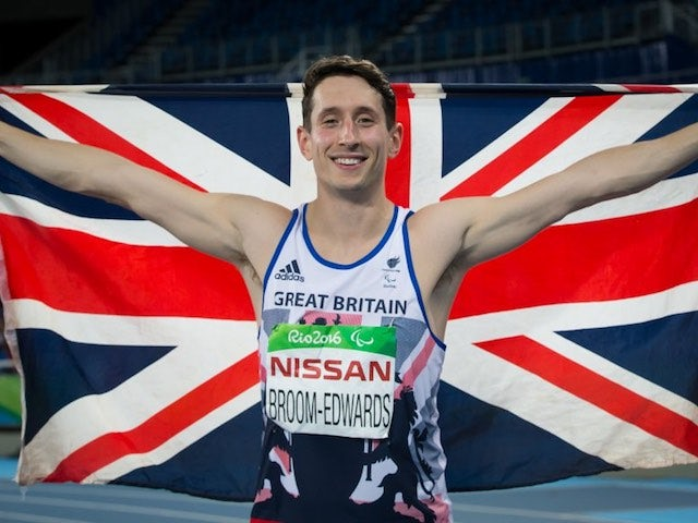 Jonathan Broom-Edwards celebrates with the GB flag after earning a silver medal in the men's high jump T44 at the Paralympic Games in Rio de Janeiro on September 12, 2016