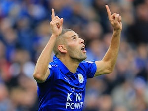 Slimani powers Leicester past Sheff United