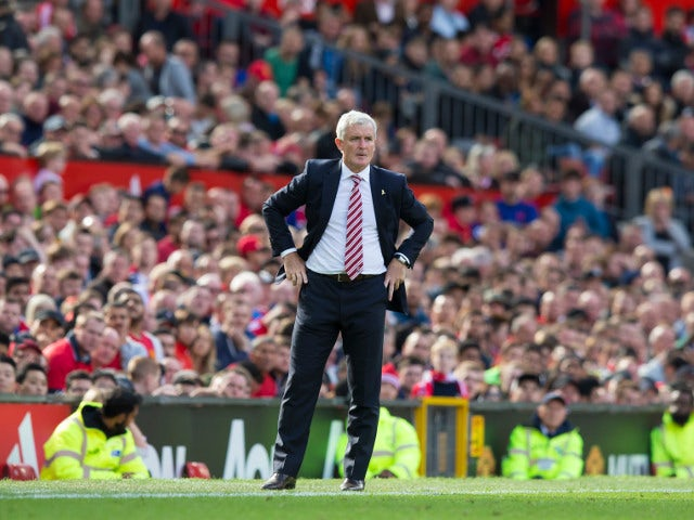 Stoke City manager Mark Hughes watches on during his side's Premier League clash with Manchester United at Old Trafford on October 2, 2016