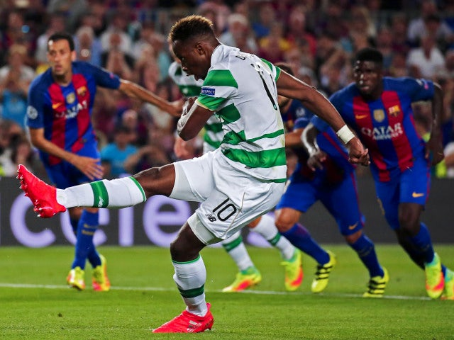 Celtic striker Moussa Dembele shoots during his side's 7-0 defeat to Barcelona in a Champions League match at the Camp Nou on September 13, 2016