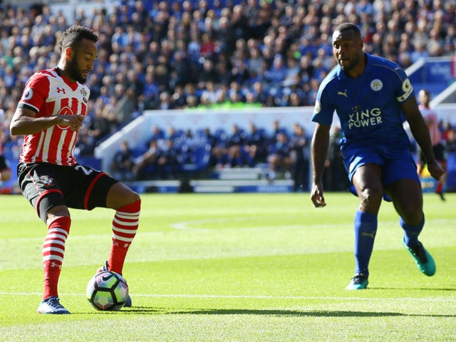 Southampton winger Nathan Redmond takes on Leicester City captain Wes Morgan during the Premier League meeting between the two sides at the King Power Stadium on October 2, 2016