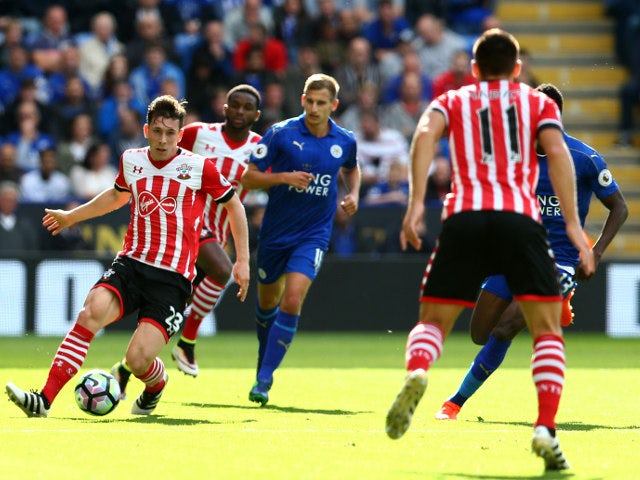 Southampton midfielder Pierre-Emile Hojbjerg is surrounded by Leicester players during the Premier League clash between the two sides at the King Power Stadium on October 2, 2016