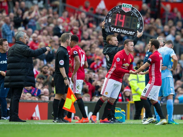 Manchester United captain Wayne Rooney replaces Juan Mata during his side's Premier League match against Stoke City on October 2, 2016