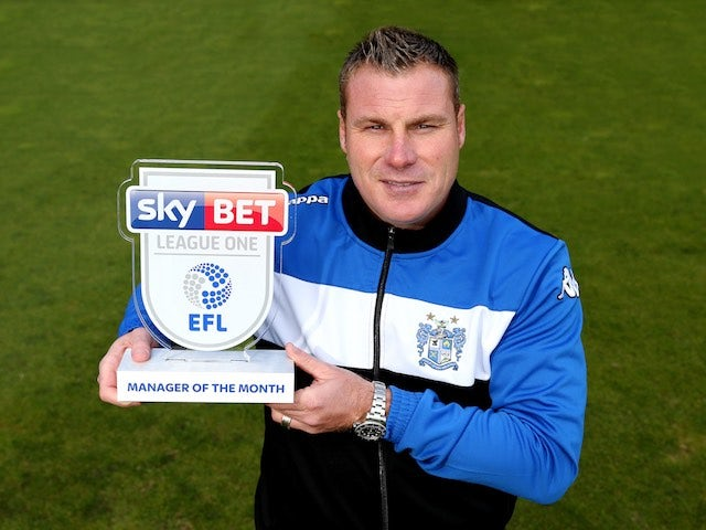 David Flitcroft poses with his Manager of the Month award for September 2016