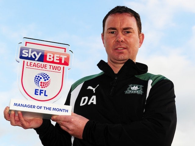 Derek Adams poses with his Manager of the Month award for September 2016