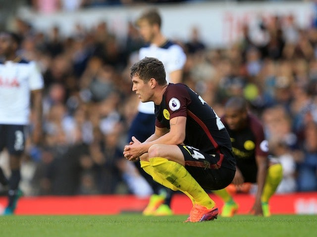 John Stones looks dejected during the Premier League match between Tottenham Hotspur and Manchester City on October 2, 2016