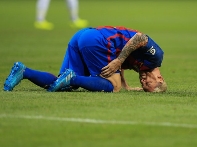 Barcelona forward Lionel Messi goes down injured during a pre-season friendly in Stockholm on August 3, 2016