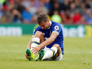 Everton captain Phil Jagielka goes down hurt during the Premier League match against Bournemouth at the Vitality Stadium on September 24, 2016