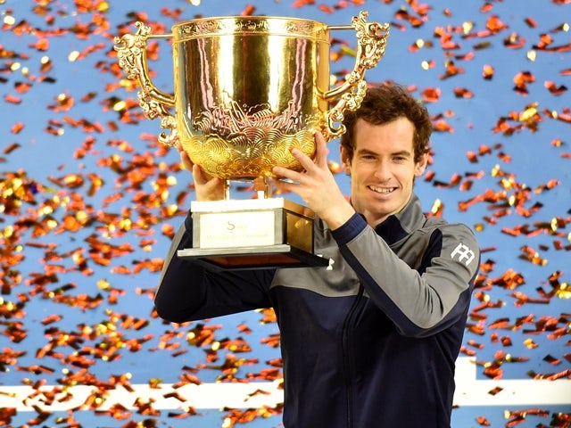 Andy Murray holds up his champion trophy at the China Open tennis tournament in Beijing on October 9, 2016
