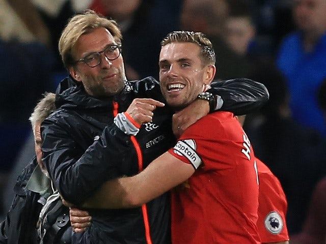 Liverpool captain Jordan Henderson celebrates with manager Jurgen Klopp following the team's Premier League victory over Chelsea at Stamford Bridge on September 16, 2016