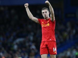 Liverpool captain Jordan Henderson celebrates following the team's Premier League victory over Chelsea at Stamford Bridge on September 16, 2016