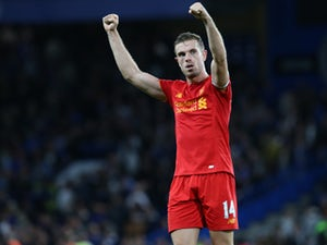 Liverpool captain Jordan Henderson celebrates following the team's Premier League victory over Chelsea at Stamford Bridge on September 16, 2016