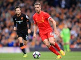 Liverpool captain Jordan Henderson runs with the ball during his side's Premier League clash with Hull City at Anfield on September 24, 2016