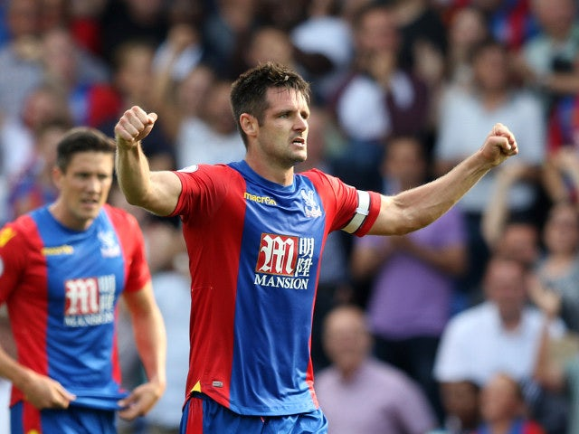 Crystal Palace defender Scott Dann celebrates after scoring the equaliser during the 1-1 Premier League draw with Bournemouth at Selhurst Park on August 27, 2016