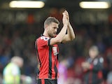 Bournemouth defender Simon Francis applauds following his side's 6-1 victory over Hull City at the Vitality Stadium on October 15, 2016