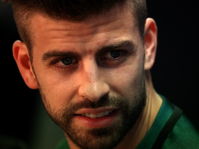 Pique signs on with Barca