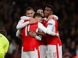 Mesut Ozil is congratulated by teammates on his hat-trick during the Champions League match between Arsenal and Ludogorets on October 19, 2016
