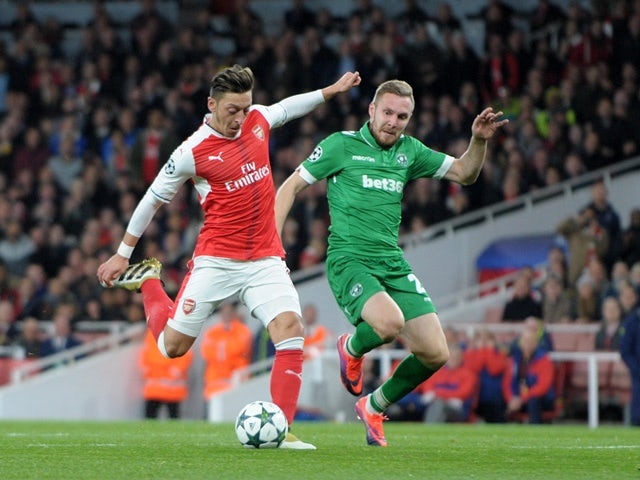 Arsenal's Mesut Ozil scores his side's fourth goal against Ludogorets on October 19, 2016