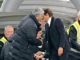 Jose Mourinho borrows old pal Wenger's coat to attend the Premier League game between Chelsea and Manchester United on October 23, 2016
