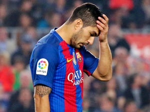 Luis Suarez out for at least four weeks