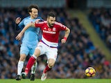 Middlesbrough striker Alvaro Negredo fends off the challenge of compatriot and former teammate David Silva during the Premier League clash with Manchester City at the Etihad Stadium on November 5, 2016