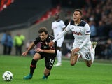 Tottenham Hotspur midfielder Dele Alli goes down under the challenge of Admir Mehmedi of Bayer Leverkusen during the Champions League Group E clash at Wembley Stadium on November 2, 2016