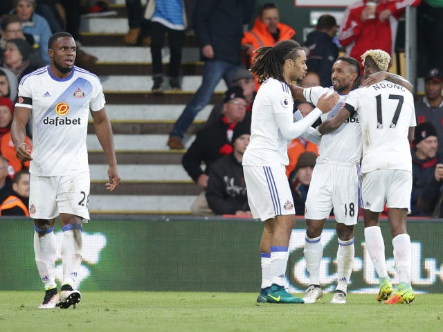 Sunderland striker Jermain Defoe celebrates with teammates after scoring the winner against Bournemouth at the Vitality Stadium on November 5, 2016