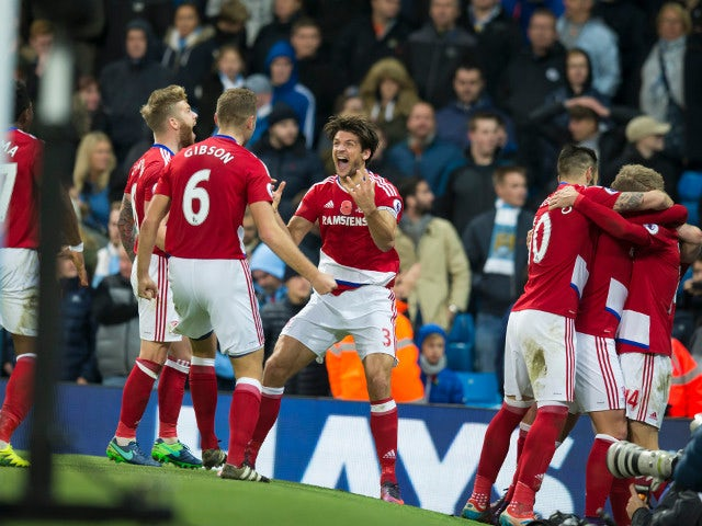 Middlesbrough midfielder Marten De Roon celebrates with teammates after scoring the equaliser in his side's Premier League clash with Manchester City at the Etihad Stadium on November 5, 2016