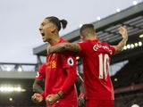 Roberto Firmino's awful haircut celbrates scoring with Philippe Coutinho during the Premier League game between Liverpool and Watford on November 6, 2016