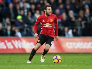 Mata 'available after flying back from Spain'