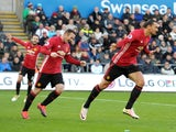 Manchester United striker Zlatan Ibrahimovic celebrates with Wayne Rooney following his goal during the Premier League clash with Swansea City at the Liberty Stadium on November 6, 2016