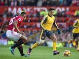 Alexis Sanchez and Antonio Valencia in action during the Premier League game between Manchester United and Arsenal on November 19, 2016