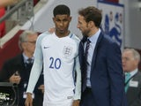 England forward Marcus Rashford speaks with interim manager Gareth Southgate during his side's international friendly with Spain at Wembley on November 15, 2016